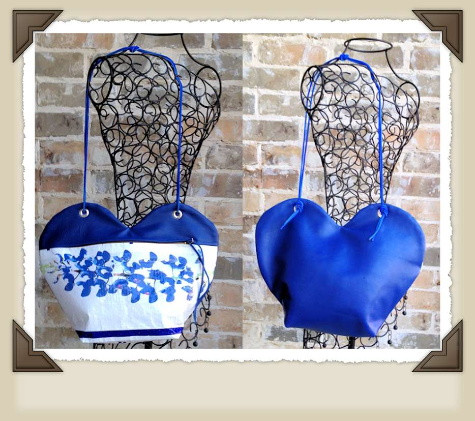 Wearable art heart shaped purse with bluebonnets and matching blue leather